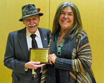 "Ms. Carol Brady, Board Member of the Marquette Regional History Center, presenting Ben Mukkala with the Helen Paul Longyear Award ""For the preservation and enhancement of history in Marquette County"""